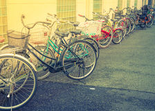 Row of bikes parking ( Filtered image processed vintage effect. Royalty Free Stock Photo