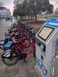 Row of bikes for rent, bike share kiosk stock images