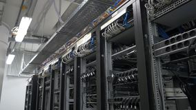 Row of bitcoin miners set up on the wired shelfs. Computer for Bitcoin mining. cables plug to motherboard for mining. Machine. Cryptocurrency computer with many Royalty Free Stock Photography