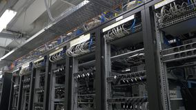 Row of bitcoin miners set up on the wired shelfs. Computer for Bitcoin mining. cables plug to motherboard for mining stock images