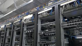 Device for mining crypto currency. Row of bitcoin miners set up on the wired shelfs. Mining cryptocurrency. Bitcoin farm Stock Images