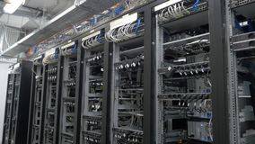 Device for mining crypto currency. Row of bitcoin miners set up on the wired shelfs. Mining cryptocurrency. Bitcoin farm stock photography