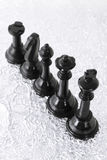 Row of black chess pieces Stock Image