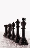 Row of black chess pieces Royalty Free Stock Photo