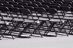 Row of black empty chairs. In an outdoor event Royalty Free Stock Photo