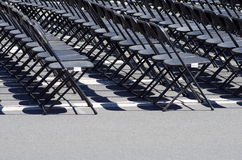 Row of black empty chairs. In an outdoor event Stock Photos
