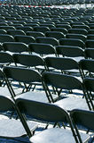 Row of black empty chairs. In an outdoor event Royalty Free Stock Photography