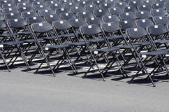 Row of black empty chairs. In an outdoor event Stock Images