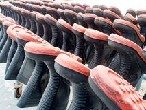 Row of black fireman boots uniforms ready for usage. Stock Photos