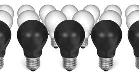 Row of black light bulbs in front of white ones Stock Photo