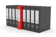 Row of black office folders and one red. Royalty Free Stock Photos