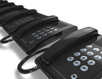 Row of black office phones Royalty Free Stock Photography