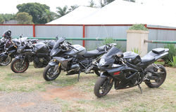 Row of black parked motorbikes at Yearly Mass Ride. Rustenburg, South Africa - March 3, 2017: Row of black parked motorbikes at Yearly Mass Ride of Tainted Souls Stock Photos