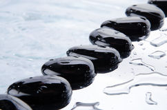 Row of black pebbles Royalty Free Stock Photography