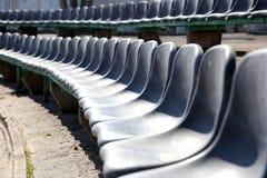 Row of black seats on tribune Royalty Free Stock Photos