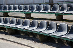 Row of black seats on tribune Stock Photo