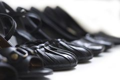 Row of Black Shoes Stock Image