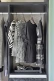 Row of black and white dress in wardrobe Royalty Free Stock Photos