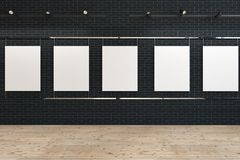 Row of blank posters on black mock up gallery. Row of uniform mock up blank posters hanging on a black brick wall of a wooden floor art gallery. Marketing, ad Vector Illustration