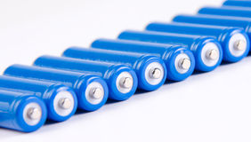 Row of blue batteries Stock Photos