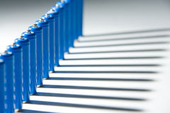 Row of blue batteries Stock Image