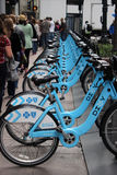 Row of blue bikes Stock Image
