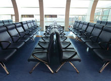 Row of blue chair at airport Stock Image