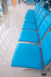 Row of blue chair Stock Images