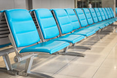 Row of blue chair in the airport Stock Image