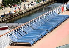 Row of Blue Chairs on Deck of Ship Stock Photography