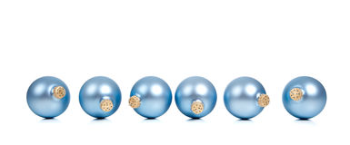 A row of blue Christmas ornaments/baubles Royalty Free Stock Image