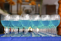 Row of blue curacao cocktail Stock Image