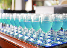 Row of blue curacao cocktail Stock Photos