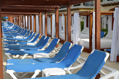 Row of blue deck chairs. Deck chairs on the beach of Playa del Carmen, Mexico Stock Photos