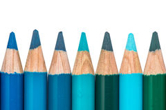 Row with Blue and Green Colored Crayons Stock Photos