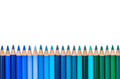 Row with Blue and Green Colored Crayons Stock Images