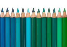 Row with Blue and Green Colored Crayons Stock Image