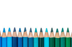 Row with Blue and Green Colored Crayons Royalty Free Stock Image