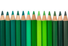 Row with Blue and Green Colored Crayons Stock Photography