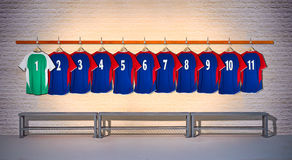 Row of Blue and Green Football Shirts 1-11 Stock Photo