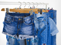 Row of blue jeans clothes on hangers in a shop Royalty Free Stock Photo