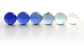 Row of Blue Marbles. An orderly row of progressively darker blue marbles Stock Images