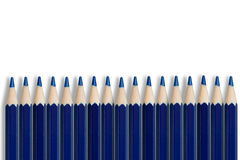 Row of blue pencils stock photos