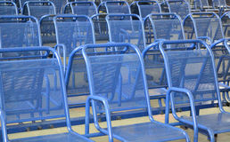 Row of blue plastic chairs Royalty Free Stock Photos