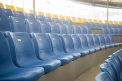 Row of blue plastic chairs on the stadium Stock Photo