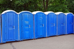 Row of blue public toilets in Moscow park Royalty Free Stock Photos