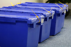 Row of blue storage containers. Secured with yellow ties stock photo