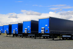 Row of Blue Trailers on a Yard Royalty Free Stock Photos
