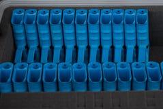 Row of blue training gun. Row of blue training pistol in box Stock Photography