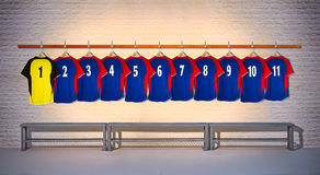Row of Blue and Yellow Football Shirts 1-11 Royalty Free Stock Images